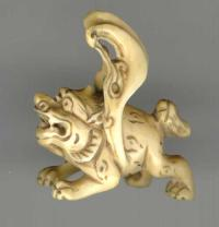 Antique Netsuke of a carved figure Ivory