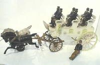 antique cast iron stagecoach with horses