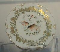 Antique Limoges fish plates by Tresseman Vogt