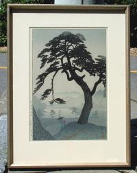 Vintage Japanese Woodblock Print of a misty landscape