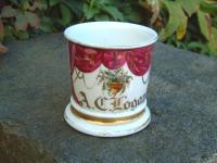 Antique porcelain shaving mug depicting drapes and flowers