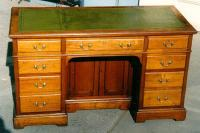 Antique English mahogany flat top desk with leather top