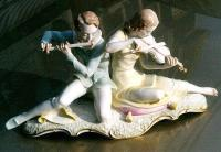 Large porcelain figural of boy playing flute and girl Hutschernreuther