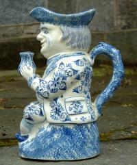 Antique Dutch delft pottery toby mug in blue and white