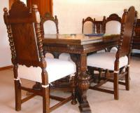 Antique carved oak dining set with French Italian design.