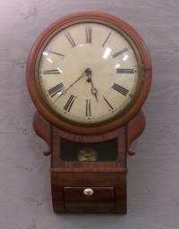 Mahogany wall clock brass movement.