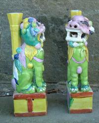 Pair of Chinese biscuit ceramic foo lion vases