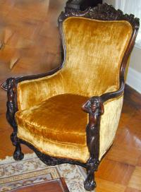 Three piece Italian upholstered parlor set with carved heads