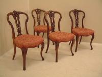 Four Victorian carved walnut upholstered chairs c1860