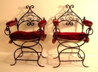Pair of hand wrought Italian iron arm chairs with twist iron base c1890