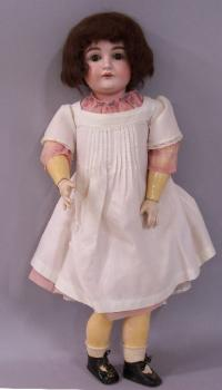 Antique German porcelain bisque doll with cloths c1880