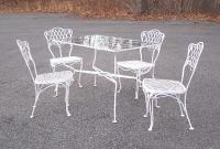 Wrought iron patio table and four matching chairs c1950