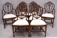Eight American Hepplewhtie style wheat carved dining chairs