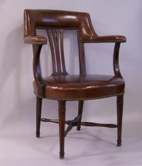 English leather and mahogany desk arm chair c1820
