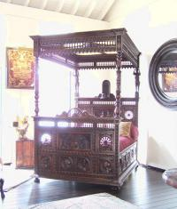 Carved French walnut four poster bed c1880