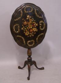 Victorian paper mache tilt top table with inlaid shells c1875