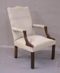 Mahogany upholstered lolling arm chair c1900