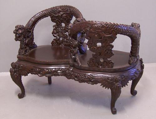 19th century Chinese carved courting chair with dragons