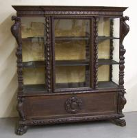 Carved fruitwood glass front china cabinet with bird corners 1875