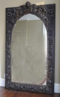 Hand carved wooden mirror with acanthus foliage flowers and putti
