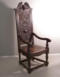 Victorian hand carved oak arm chair with griffins and urn c1860