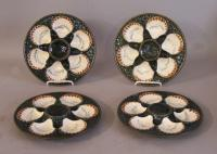 Set of four French Majolica oyster plates c1920