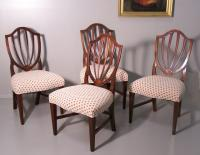Set of four American Centennial inlaid upholstered shield back dining chairs