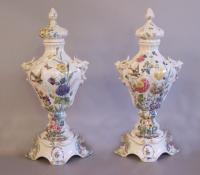 Pair of 19th c. Italian Nove faience porcelain lidded urns on bases