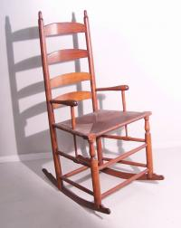 Early American ladder back rush seat rocker with arms c1760
