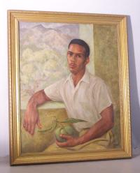 Portrait of Cuban or Carribean man holding mango