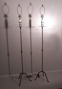 Pair of wrought iron arts and crafts floor lamps c1910