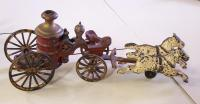Castiron toy firemans pumper wagon with horses