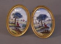 Pair of early porcelain oval brass mirror tiebacks