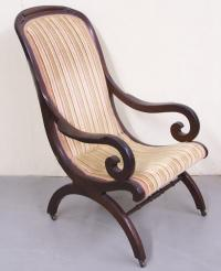 Victorian Walnut Upholstered Chair with rolled arms.