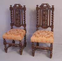 Pair English Jacobean style carved oak tall back side chairs