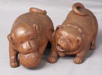 Carved wood model of two Japanese puppies with ball c1900