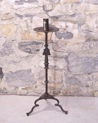 Early hand wrought iron torchiere with crest