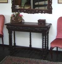 Oak console table with drawer carved with scrolls c1890