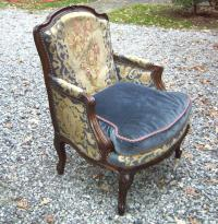 Louis XV style walnut bergere in tapestry and velvet upholstery