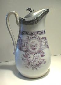 Antique porcelain syrup jug with pewter top