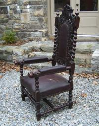 Carved oak chair w  twist turned arms dogs heads leather seat