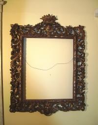 Early hand carved french hanging wall mirror with crest c1800