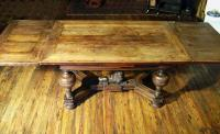 German Renaissance oak drawer table with carved lion