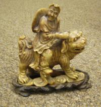 Chinese soapstone man on foo lion