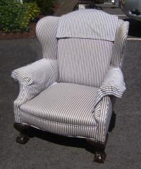 Victorian claw foot upholstered wing chair c1900