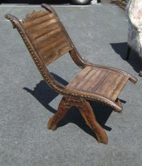 Early Asian teak lounge chair