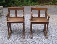 Pair of early primitive French church chairs c1700