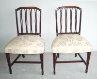 Pr Regency upholstered pierce carved mahogany chairs
