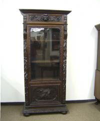 19th century carved oak bookcase with lions heads c1850