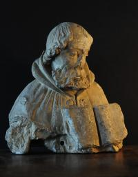 French 16th century limestone carving of a man with a book